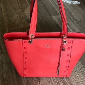 Red Guess tote. Stud detail